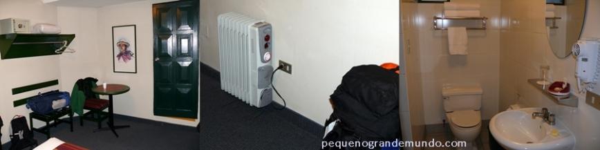 Quarto, aquecedor e banheiro no Casa Andina
